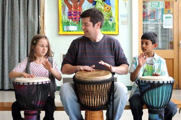 chris-greer-from-school-drumming-works-with-year-2-pupils-holly-smith-and-dilraj-sohal-756594363