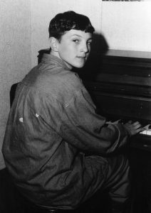 This mid 1990s photograph shows Jimmy Henderer '96 practicing the piano.
