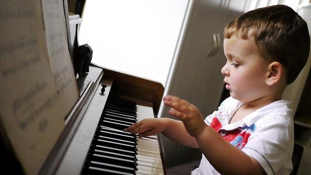 boy learning piano