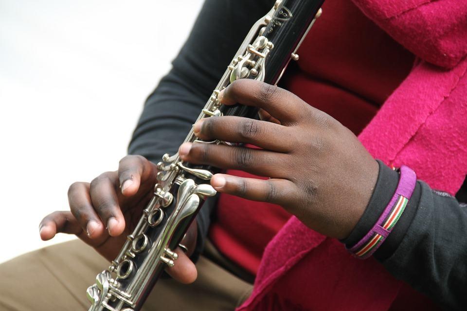 child holding instrument