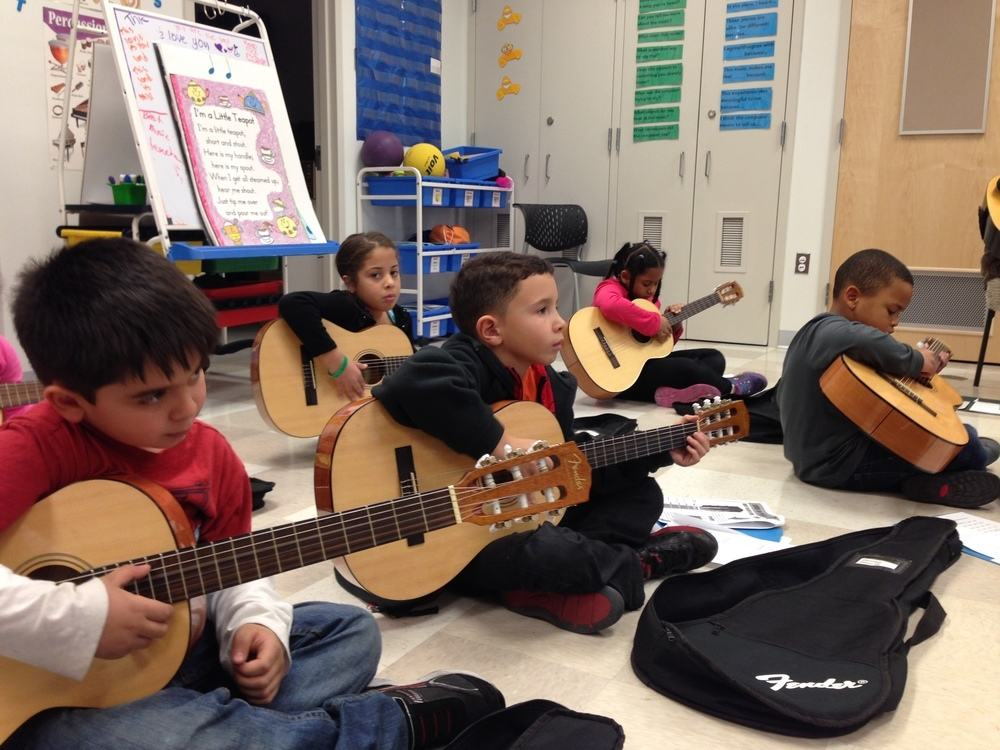 children learn guitar