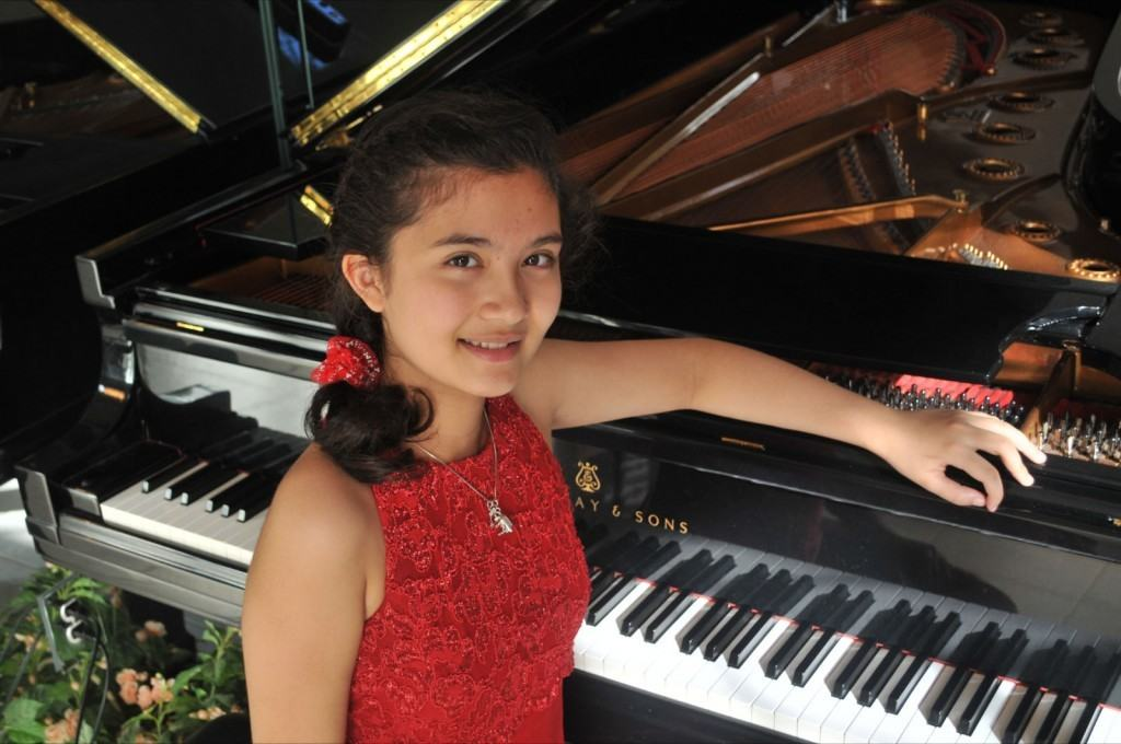 young girl pianist