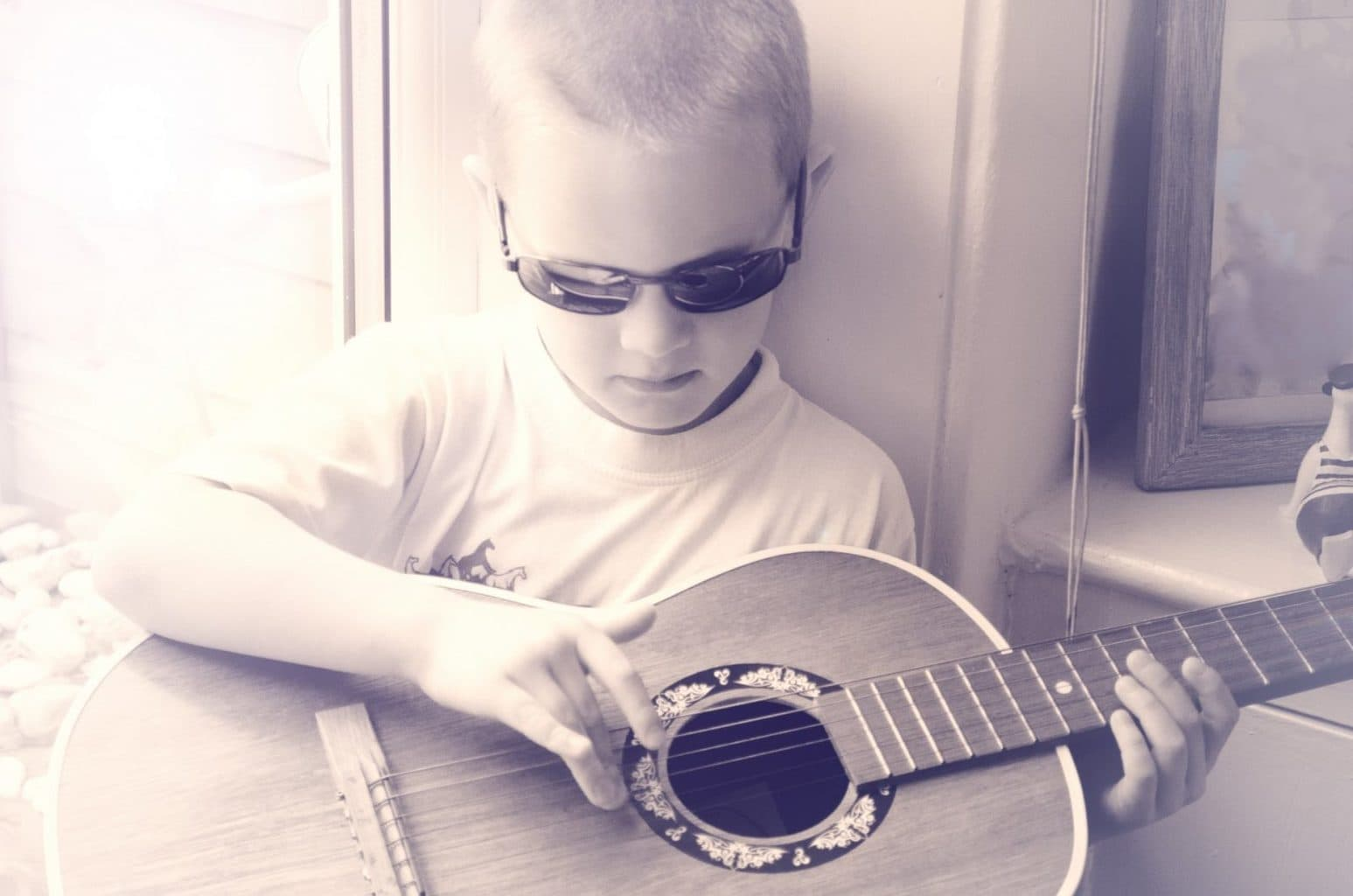 boy plays guitar