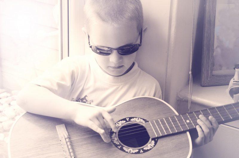 boy plays guitar