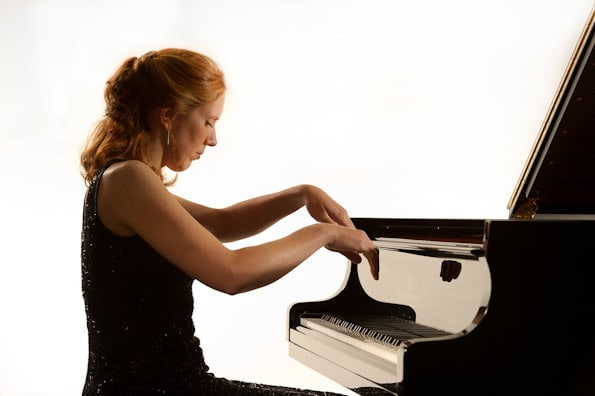 woman plays the piano