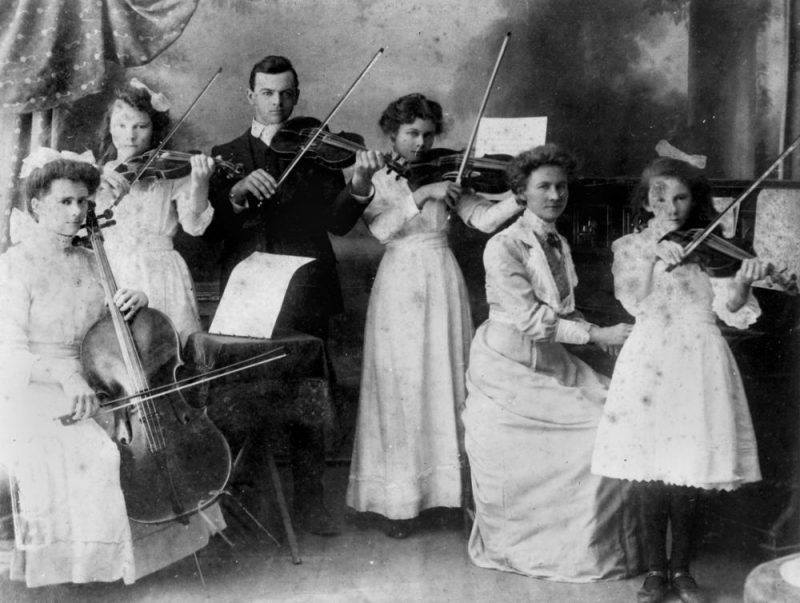 parents and children performing music together