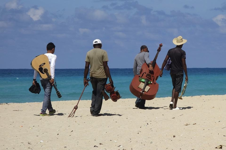 music band members walking to the beach