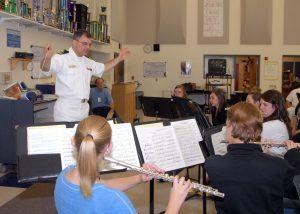 a music teacher conducting a music lesson