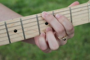 holding a chord