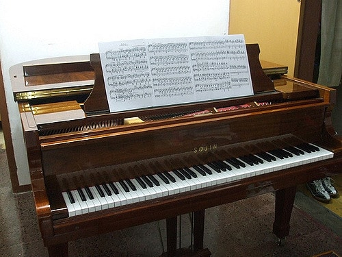 a piano with music sheet