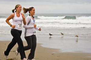 two ladies jogging at the beach