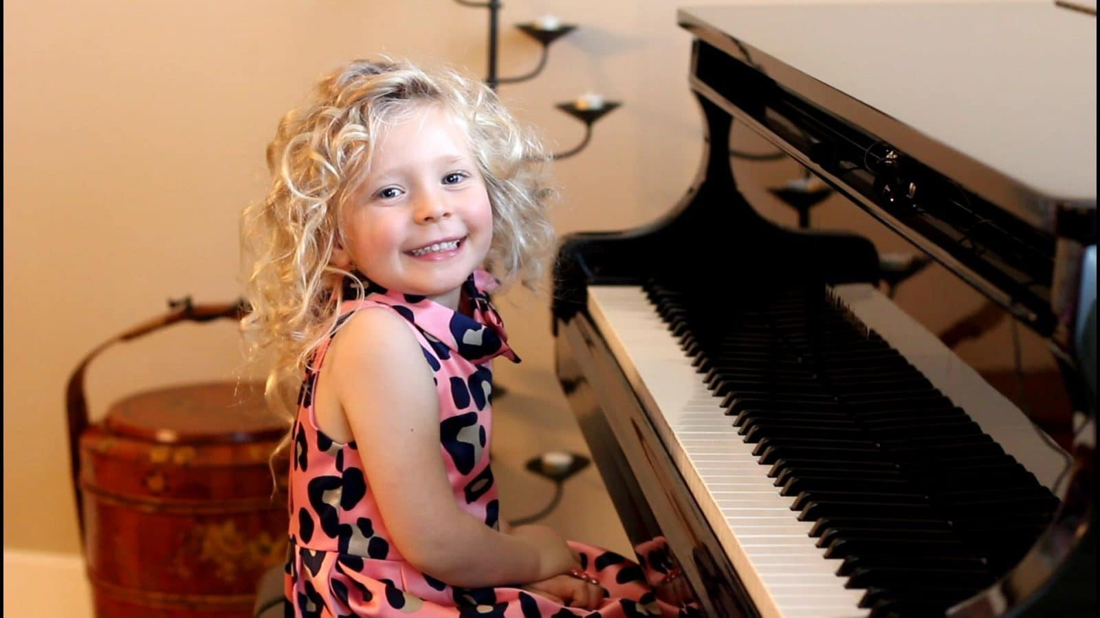 happy girl playing the piano