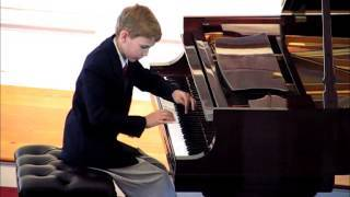 boy learning the piano