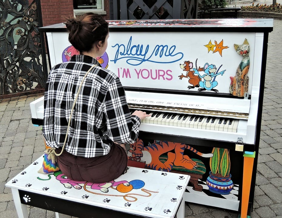 lady playing the piano outdoors
