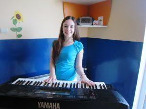 girl playing the keyboard
