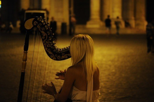 woman playing a string instrument