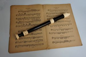 a flute and an old music sheet