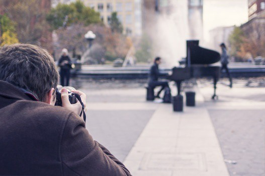 photographer taking a photo of a pianist