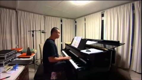 man practising the piano