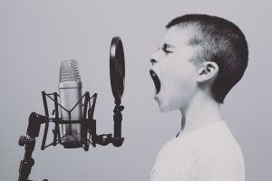 boy screaming into the microphone