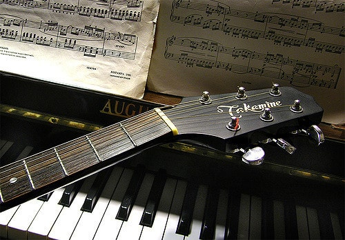a guitar and a piano together