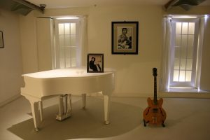the piano and guitar in a room