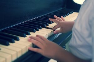 playing the piano with small hands