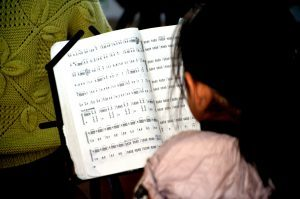 a child reading sheet music