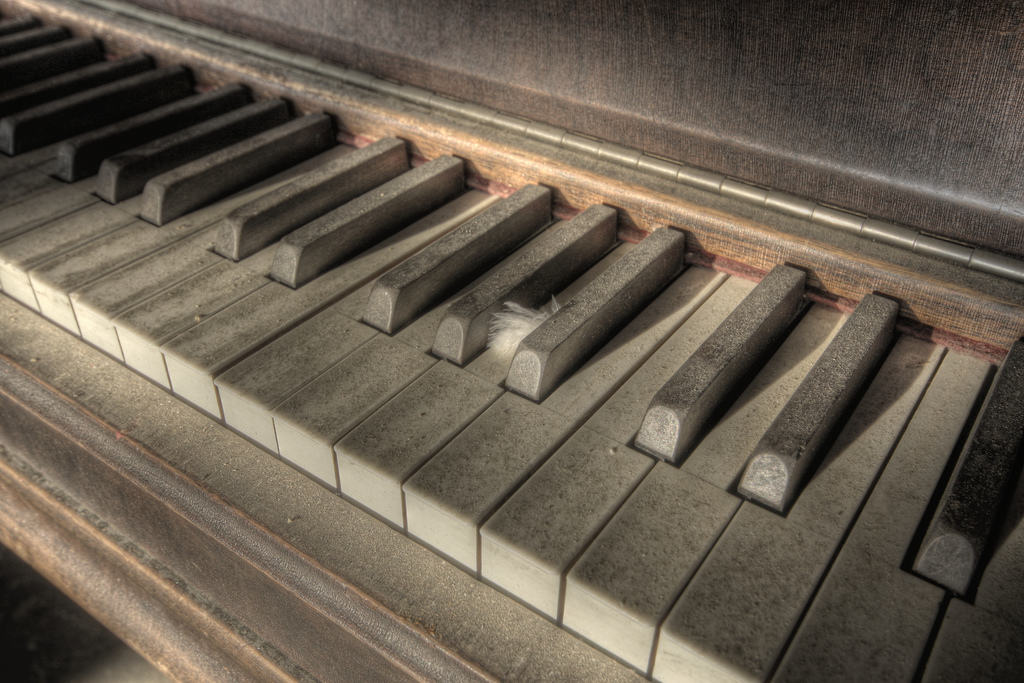a dusty abandoned piano