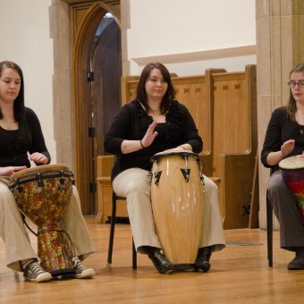 ladies playing different drums