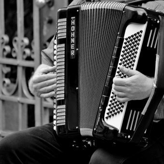 man playing playing the accordion